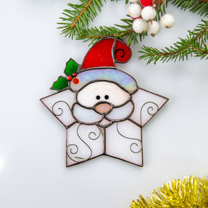 Snowflake Santa suncatcher of stained glass for winter window decor