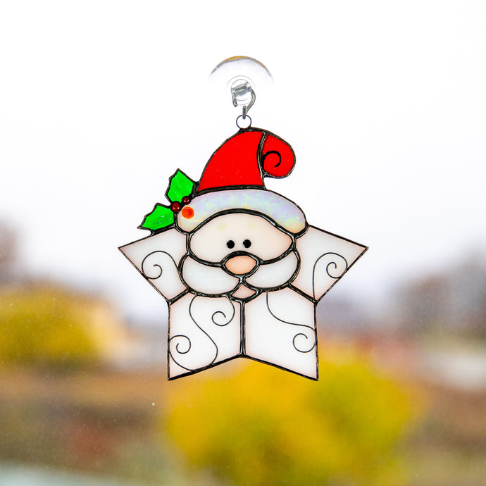 Stained glass Santa shaped as a snowflake suncatcher for Christmas window decor