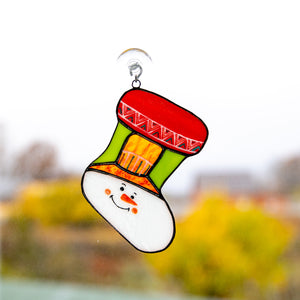 Stained glass Christmas stocking depicting snowman's face window hanging