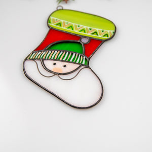 Zoomed stained glass Christmas stocking depicting Santa