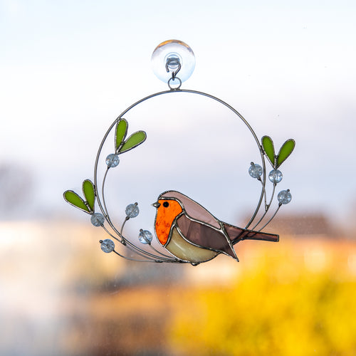 Stained glass robin bird with the mistletoe of wire suncatcher