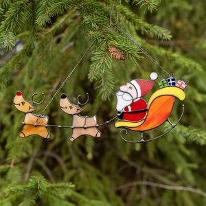 Stained glass Santa's reindeer team suncatcher used as a New Year Tree decoration