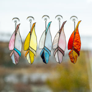 The collection of stained glass bright colourful feathers
