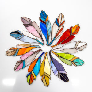 The variety of stained glass feather window hangings