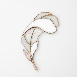 Minimalistic white coloured feather with iridescent parts suncatcher
