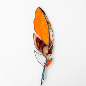 Stained glass orange feather suncatcher with bardic blotchiness