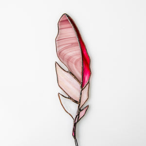 Pink with blotchiness stained glass feather suncatcher