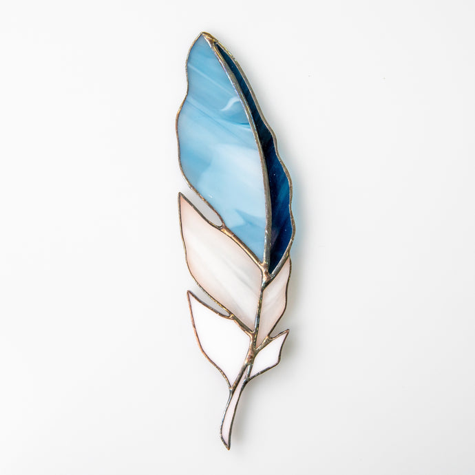 Suncatcher of a stained glass sky-blue  with white and navy colours feather