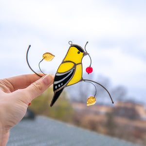 Suncatcher of a stained glass goldfinch for window decoration