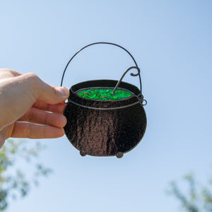 Stained glass black witch's pot with green poison suncatcher