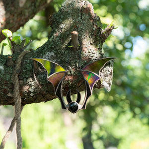 Iridescent-winged stained glass bat suncatcher for spooky Halloween decor