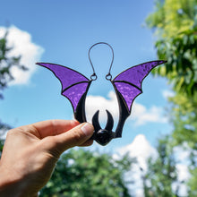 Load image into Gallery viewer, Suncatcher of a stained glass bat with purple wings