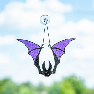 Window hanging of a stained glass purple bat for Halloween decor