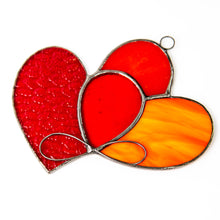 Load image into Gallery viewer, Zoomed stained glass eternity symbol on stained glass hearts suncatcher