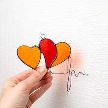Load image into Gallery viewer, Stained glass orange hearts with heartbeat suncatcher for Valentines day