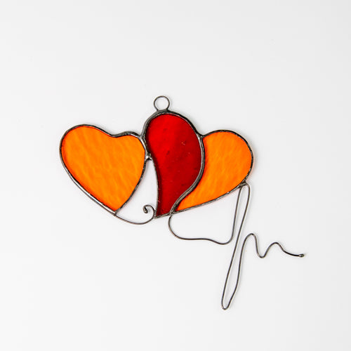 Stained glass two orange hearts suncatcher with red part suncatcher and with the wired heartbeat