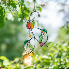Load image into Gallery viewer, Stained glass suncatcher of two hummingbirds with flower above them