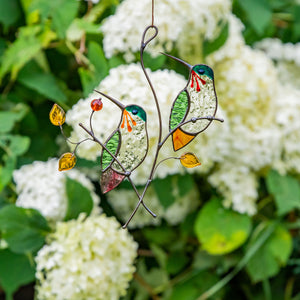 Two stained glass hummingbirds on the branch with leaves and berries suncatcher