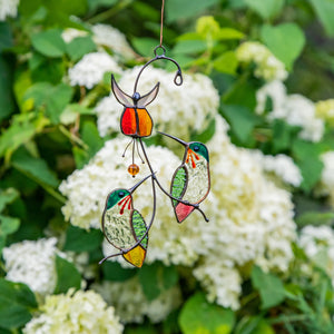 Pair of stained glass hummingbirds with red flower window hanging