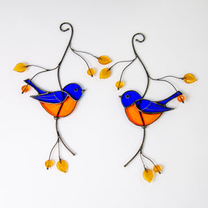 Pair of bluebirds sitting on the branch with leaves and berries stained glass suncatcher