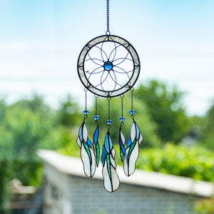Light-blue dreamcatcher with feathers of different shades of blue of stained glass