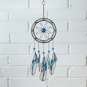 Light-blue stained glass dreamcatcher with blue feathers for home decor