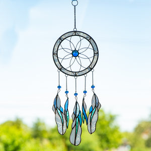 Stained glass light-blue flower-shaped dreamcatcher with feathers of different shades of blue