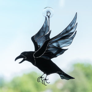 Stained glass flying raven with blotchiness on wings suncatcher for window decoration