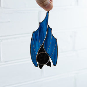 Stained glass upside-down blue bat window hanging