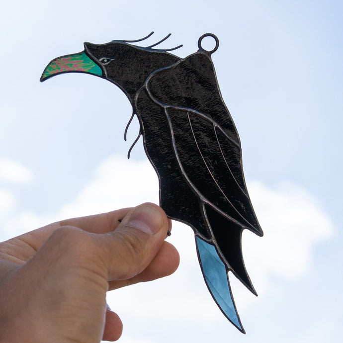 Window hanging of a stained glass raven