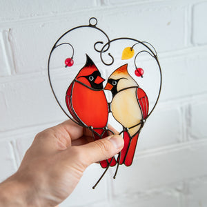 Suncatcher of a stained glass pair of cardinals on the branch