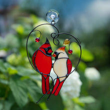Load image into Gallery viewer, Stained glass of male and female Cardinals sitting on the heart-branch window hanging