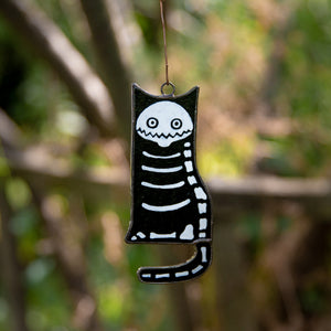 Stained glass suncatcher of a cat skeleton for ghastly Halloween decor