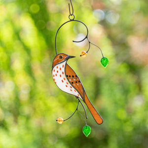 Stained glass brown thrasher sitting on the branch with leaves and berries suncatcher for home decor