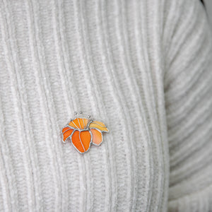 Orange lily brooch of stained glass