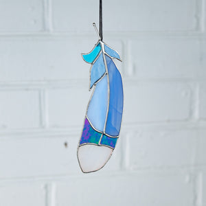 Suncatcher of stained glass bluejay feather