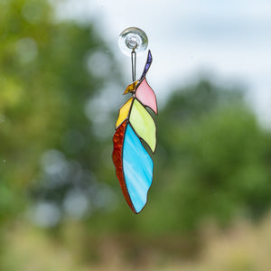 Colourful stained glass feather window hanging