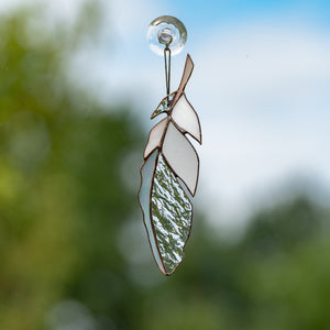 Suncatcher of a stained glass white and clear feather
