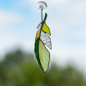 Green with clear parts stained glass feather window hanging