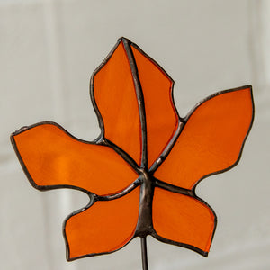 Zoomed stained glass orange maple leaf suncatcher