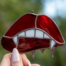 Load image into Gallery viewer, Zoomed stained glass vampire lips and teeth window hanging for Halloween decor