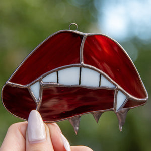 Zoomed stained glass vampire lips and teeth window hanging for Halloween decor