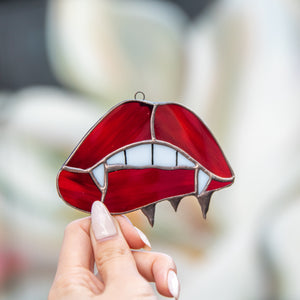 Stained glass vampire teeth on red lips suncatcher for Halloween