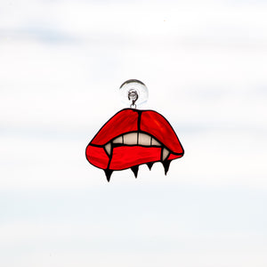 Stained glass suncatcher of vampire lips and teeth