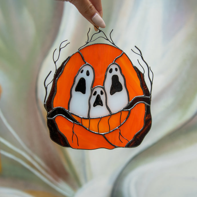Stained glass ghost-eyed pumpkin suncatcher for spooky Halloween decor