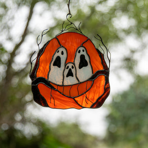 Stained glass pumpkin with ghost-eyes window hanging