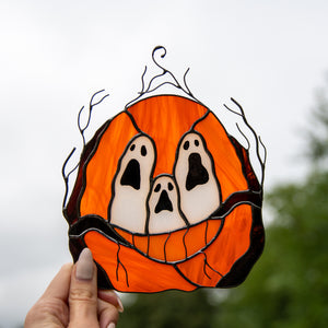 Stained glass pumpkin with ghost-eyes window hanging for spooky Halloween decor