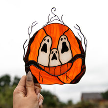 Load image into Gallery viewer, Stained glass suncatcher of spooky ghost-eyes pumpkin