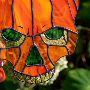 Zoomed stained glass pumpkin skull suncatcher for halloween