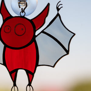 Zoomed stained glass Halloween red bat window hanging
